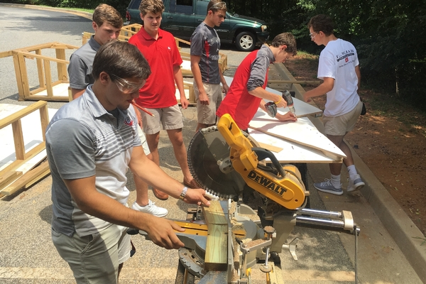 Mr. Cole's sculpture class working on the GW for the front entrance lawn.