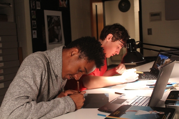 Art students working on Prisma drawings for new offices and the PARC.